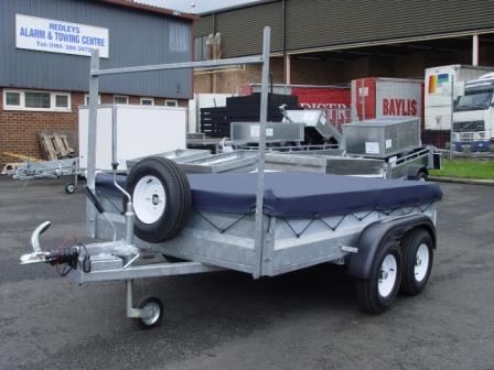 Trailer With Cover And Ladder Rack
